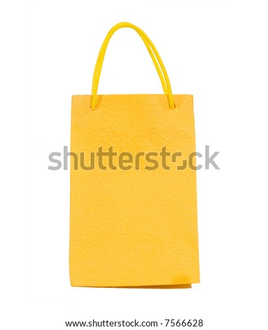 Yellow bag isolated on white (clipping path) - stock photo