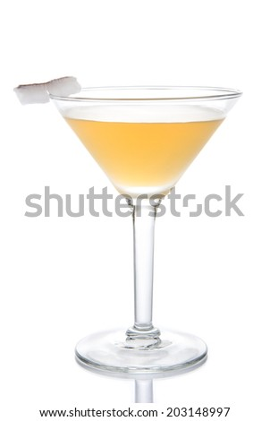 Yellow banana cocktail in martini glass with lemon and coconut slice isolated on a white background - stock photo