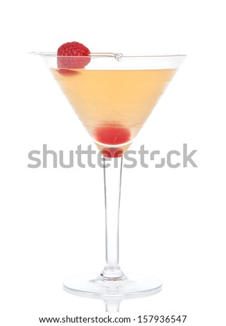 Yellow banana pineapple cocktail drink in martini glass with raspberry isolated on a white background - stock photo