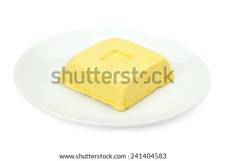 yellow bean curd or tofu in dish isolated on white background with path  - stock photo