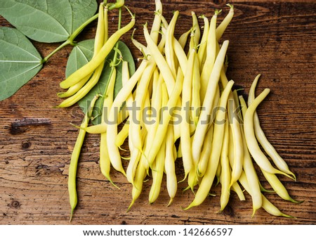 yellow beans -  on a wooden background - stock photo