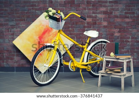 Yellow bicycle with books on brick wall background - stock photo