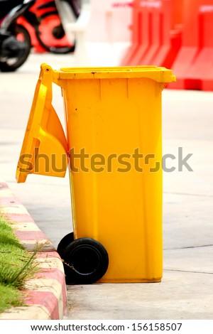 Yellow bin - stock photo