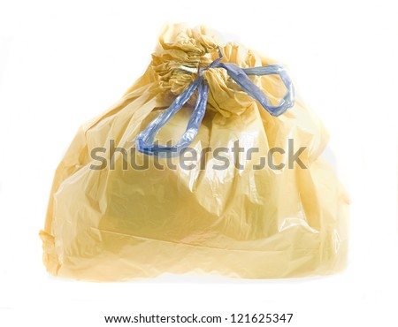 yellow bin bag isolated on a white background - stock photo