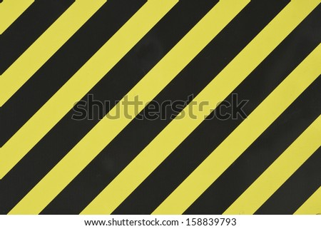 Yellow black diagonal stripes as an abstract pattern background - stock photo