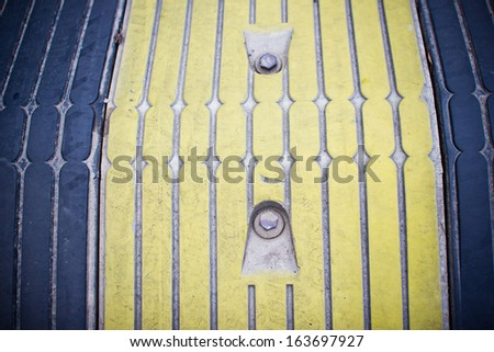 Yellow black speed bump closeup texture - stock photo