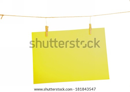 Yellow blank paper sheet on a clothes line. Isolated on white background.  - stock photo