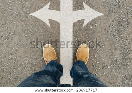 yellow boots on the road - stock photo