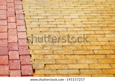 Yellow Brick paving edged with red bricks - stock photo