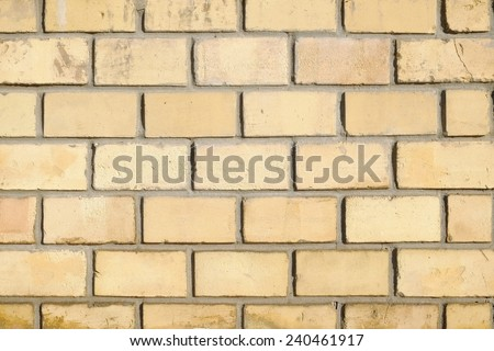 yellow brick wall background  - stock photo
