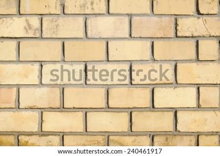 yellow brick wall background  - stock photo