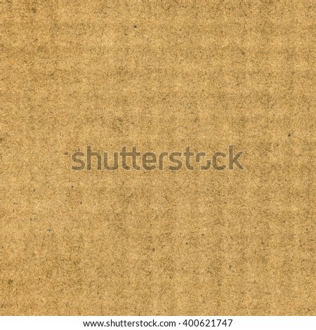 yellow-brown cardboard texture as background - stock photo