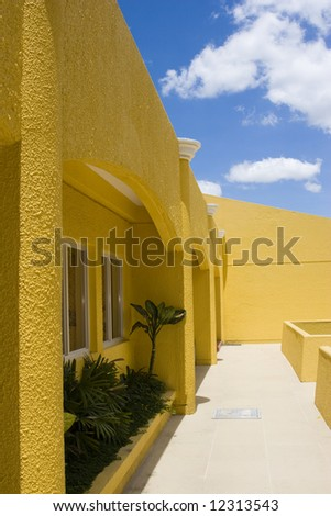 yellow building, blue sky - stock photo