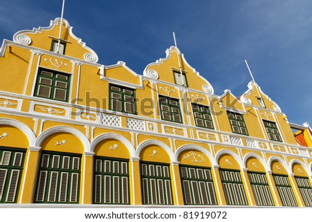Yellow building in the old town in Willemstad, Curacao - stock photo