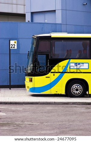 yellow bus and bus station - stock photo