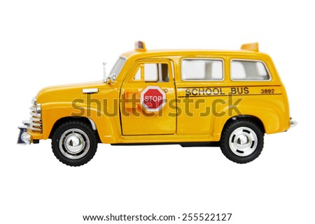 Yellow bus toy isolated on white background - stock photo