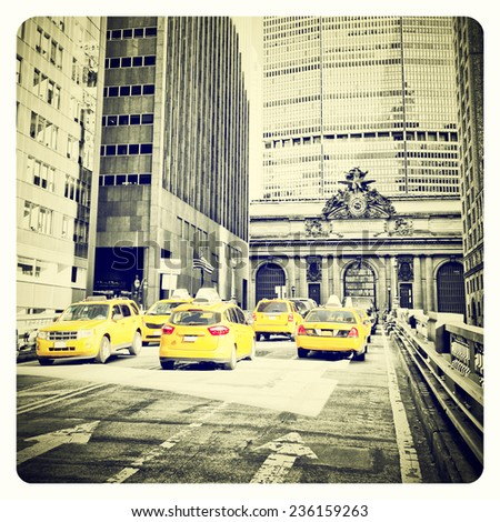 Yellow cabs on Park Avenue in front of Grand Central Terminal, New York with Instagram effect filter - stock photo