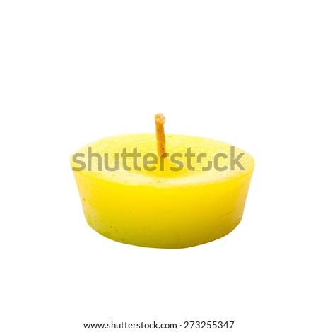Yellow candle isolated on white background - stock photo