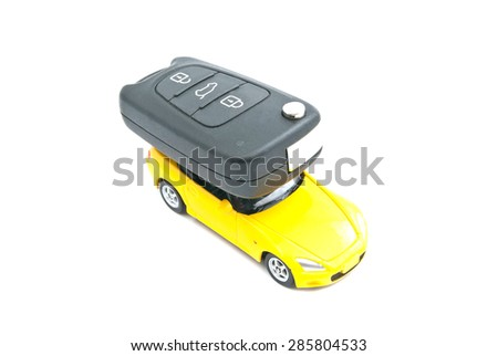 yellow car and car keys on white background - stock photo