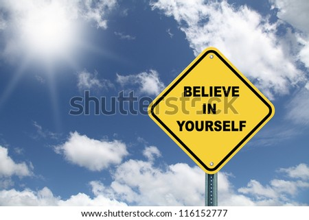 Yellow cautionary road sign Believe in yourself against a beautiful sky background - stock photo