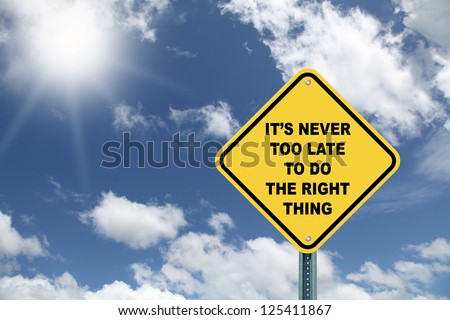 Yellow cautionary road sign It's never too late to do the right thing on beautiful sky background - stock photo