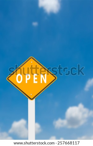 yellow cautionary road sign open against a beautiful sky background - stock photo