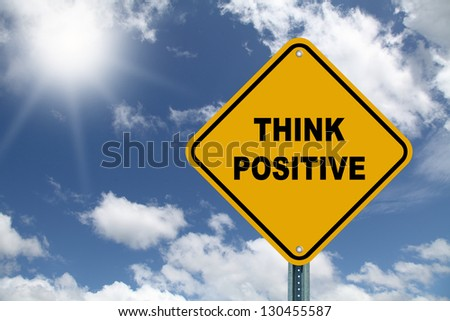 Yellow cautionary road sign Think Positive - stock photo