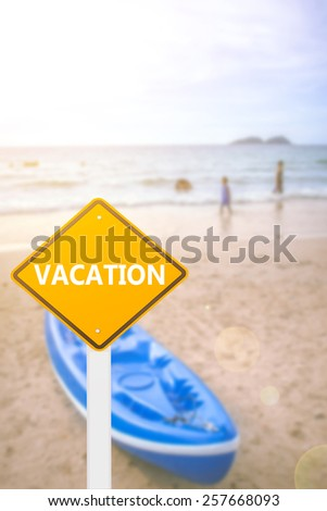 yellow cautionary road sign vacation against a beautiful beach and sky background - stock photo