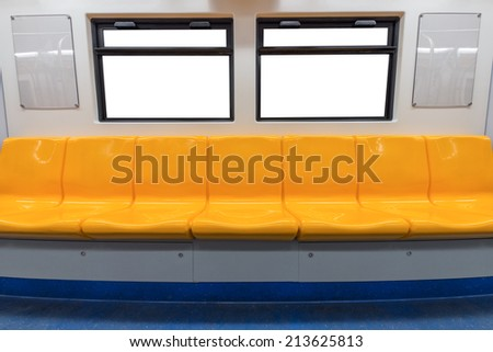 Yellow chair and windows in electric train - stock photo