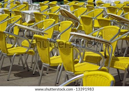 Yellow chairs in lines - stock photo