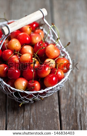 Yellow cherries in a basket - stock photo
