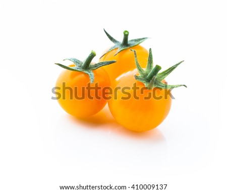 yellow cherry tomatoes isolated on white - stock photo