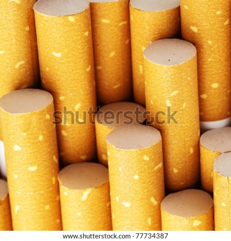 Yellow cigarette filters close-up, square cropping - stock photo