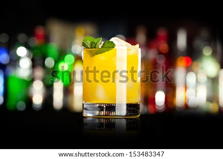 Yellow Cocktail with Mint - stock photo