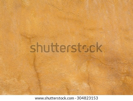 yellow concrete wall with some cracked  - stock photo