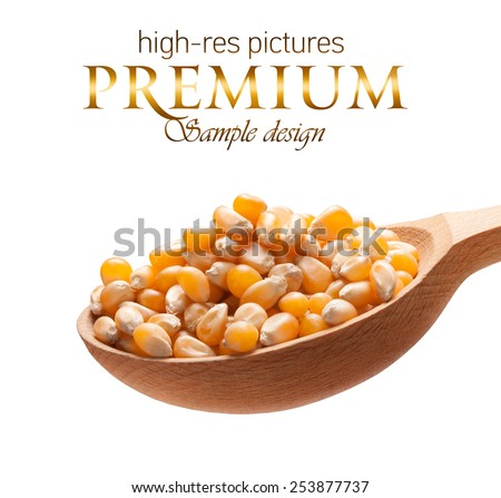 Yellow corn in a wooden spoon / kernels on wooden spoon isolated on white background with place for your text   - stock photo