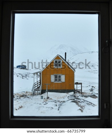 Yellow cottage in the Kulusuk village, Greenland - stock photo