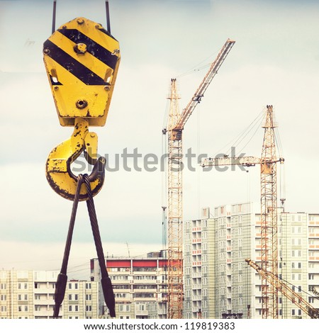 yellow crane hook , construction site - stock photo
