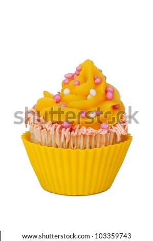yellow cupcake with whipped cream and pink baby girl rusk - stock photo