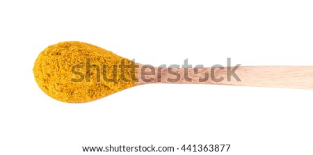 Yellow curry powder in the wooden spoon, isolated on white background. - stock photo