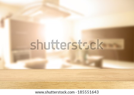 yellow desk and kitchen in sun light  - stock photo
