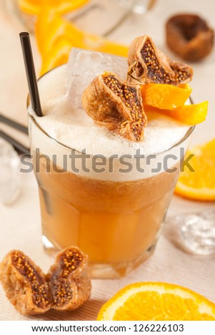 Yellow drink with figs - stock photo