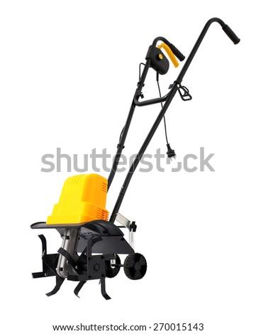 Yellow electric tiller for garden - stock photo