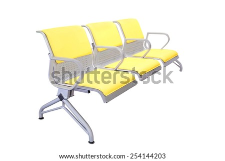 Yellow empty chairs under the white background - stock photo