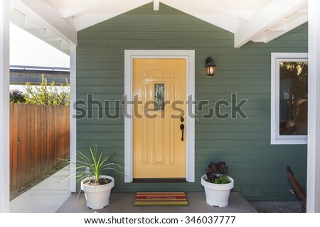 Yellow entry door / front door with single cylinder entrance handle-set. - stock photo