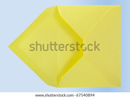 Yellow envelope isolated on the blue surface. - stock photo
