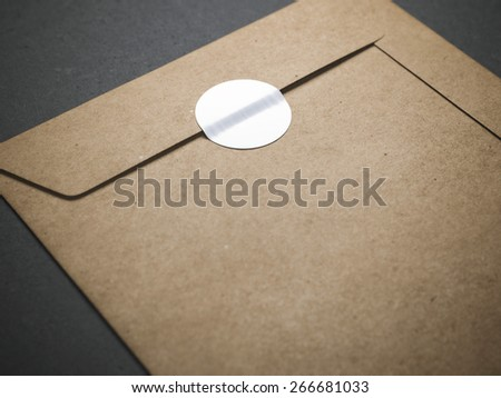Yellow envelope with blank sticker - stock photo