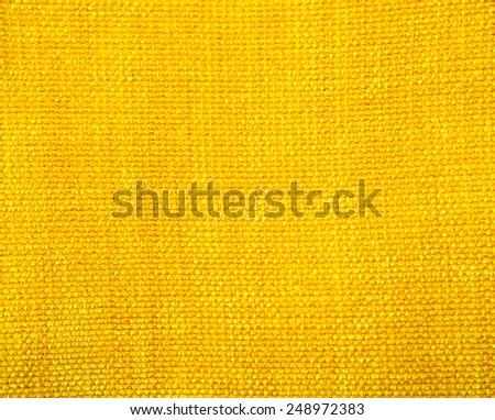 Yellow fabric background - stock photo