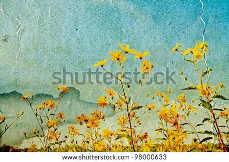 yellow field flowerses on grunge background - stock photo