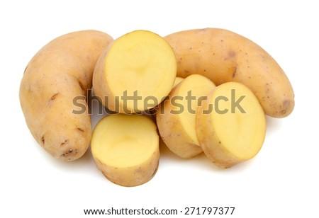 yellow fingerling potatoes on white background  - stock photo